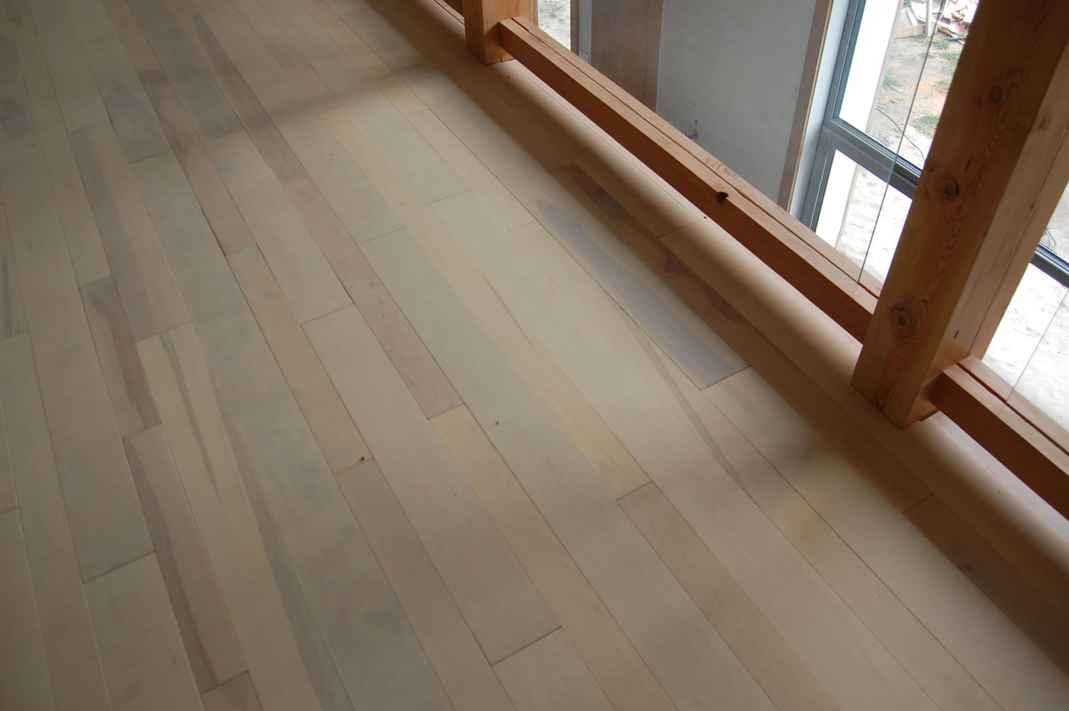 Reclaimed birch flooring from Log's End